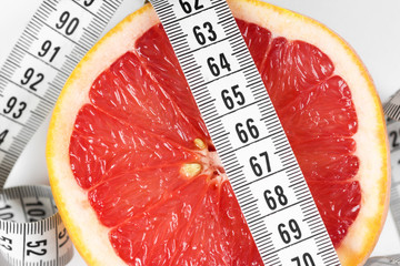Measuring tape with grapefruit