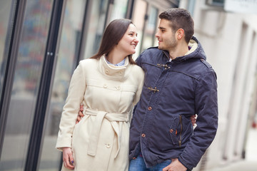 Young couple embracing in a walk