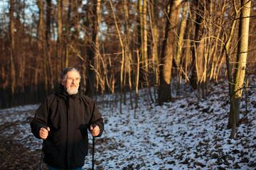 Senior man nordic walking, enjoying the outdoors, the fresh air,