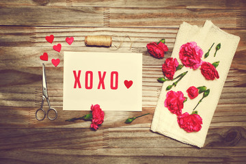 Xoxo love theme with scissors, twine, and carnation flowers