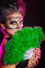 Girl in masquerade mask