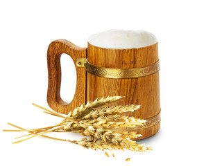wooden mug with beer and wheat isolated on the white background