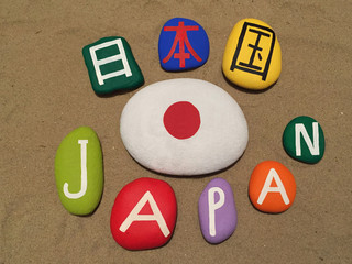 Japan with national flag on colored stones