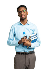 Happy african american college student standing with books and b