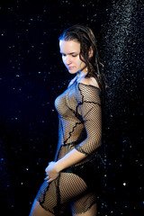 Sexy pretty woman standing in black aqua studio Rain shower