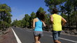 Running sport - runners jogging on mountain road