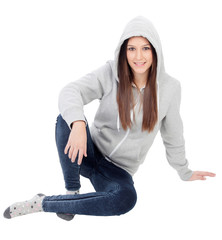 Happy hooded girl with grey sweatshirt sitting on the floor