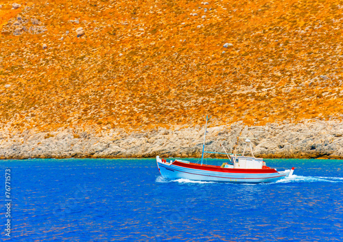 Leinwanddruck Bild traditional fishing boat at Kalymnos island in Greece