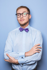 Young fashion male model wearing bow tie and blue shirt
