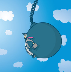 Businessman pushed by giant wrecking ball