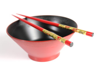 chopsticks and red Japanese bowl