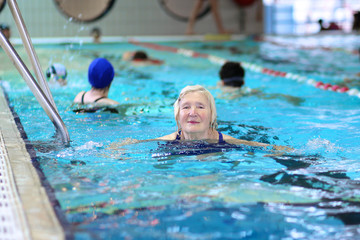 Healthy senior woman swimming in the pool