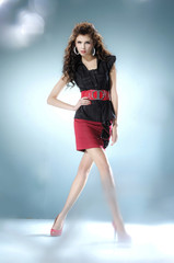 Full length fashion or casual girl posing on light background