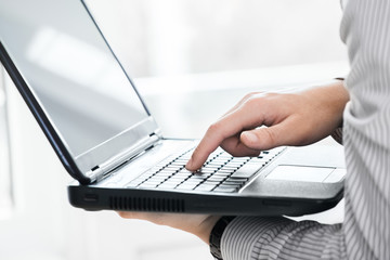 Image of businessman working on laptop