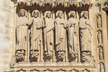 Statues of six apostles on the facade of Notre Dame cathedral