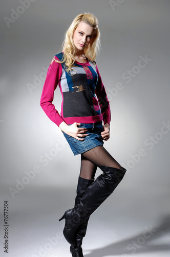 Poster Full length portrait of young fashion blond female posing