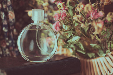 perfume on a background of dried flowers