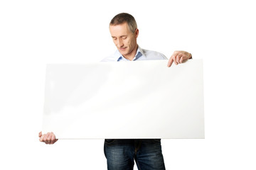 Handsome man holding an empty banner