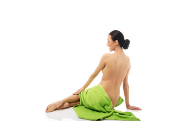Woman sitting wrapped in towel