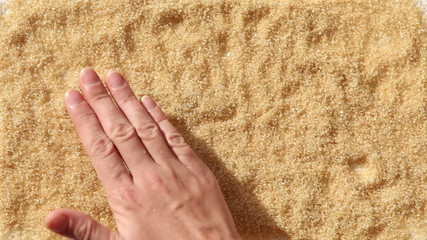 man palm smooth word LOVE on brown sugar surface