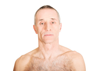 Shirtless mature man with serious look