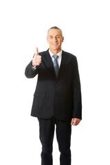 Mature businessman gesturing ok sign