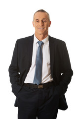 Smiling businessman with hands in pocket