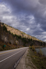 Mountain road under a cloudy sky