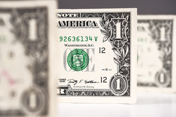 Close up of one dollar for background.