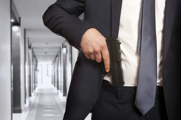 Businessman holding a gun
