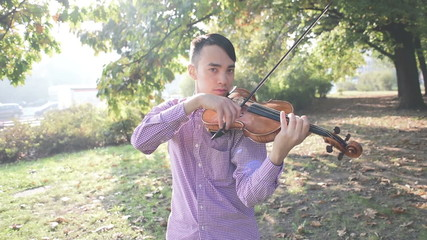 young crazy funny musician violinist asian man in town outdoor l