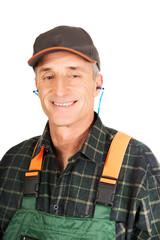 Mature worker wearing ear protectors