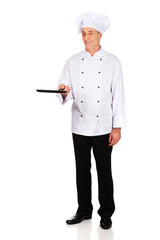 Restaurant chef with frying pan