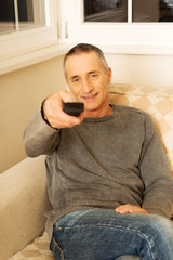 Mature man with remote control