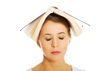Woman holding book on head