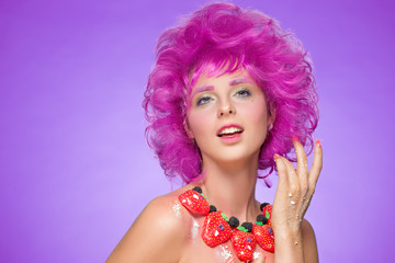 girl with pink hair. a necklace of candy