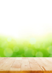 Wood table top on abstract white & green bokeh background