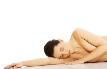 Beautiful caucasian naked woman lying down