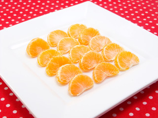 orange on white plate