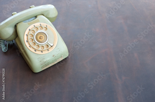 Foto op Plexiglas Retro Old phone on leather background