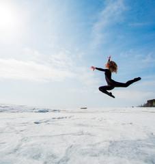 beautiful beautiful girl jumping in the snow
