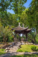 Chinese classical garden with pavilions and pond