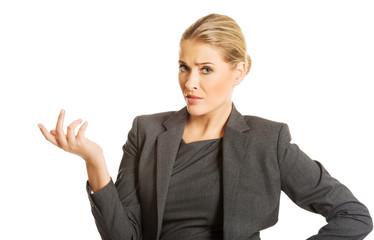 Confused woman showing irritate gesture