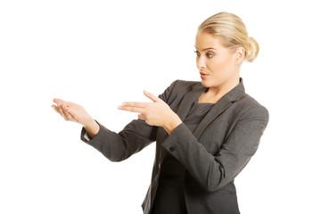 Business woman showing copy space