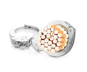 Addition concept with cigarettes and handcuffs