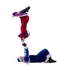 Funny acrobats perform in New Year costumes