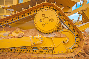 very close up view the track of bbulldozer on sand