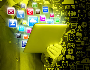 Business man use tablet pc with colorful application icons