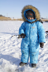 Winter fishing Young fisherman