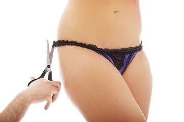 Men cutting off woman's panties.